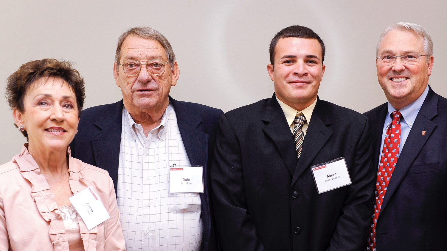 Genia and Dale Bone (left) with Bone Scholar Aaron Becerra and NC State Chancellor Randy Woodson (far right).