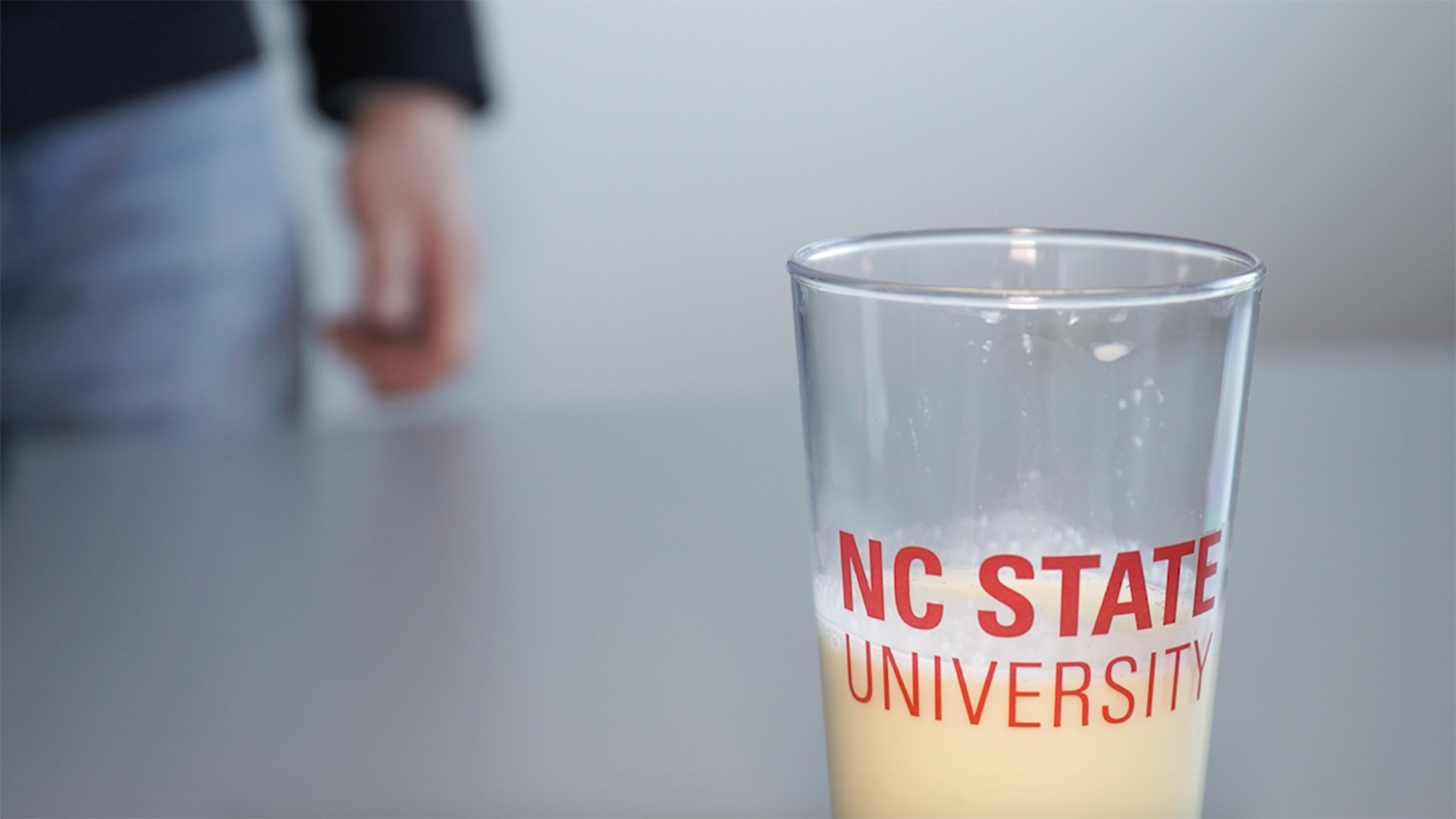 eggnog in an NC State branded pint glass