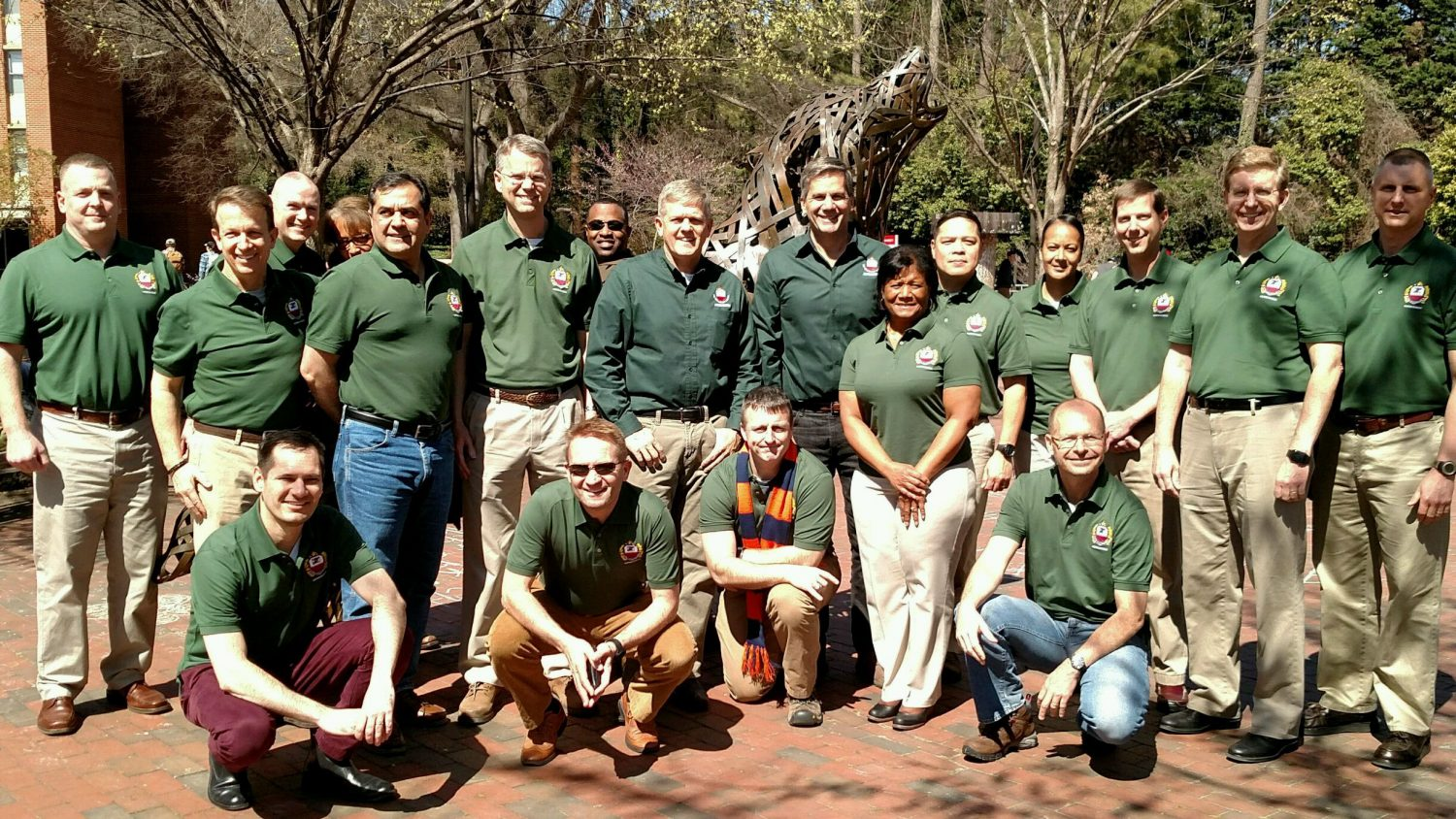 The Eisenhower School's Agribusiness Industry Study Group posing in front of a wolf statue