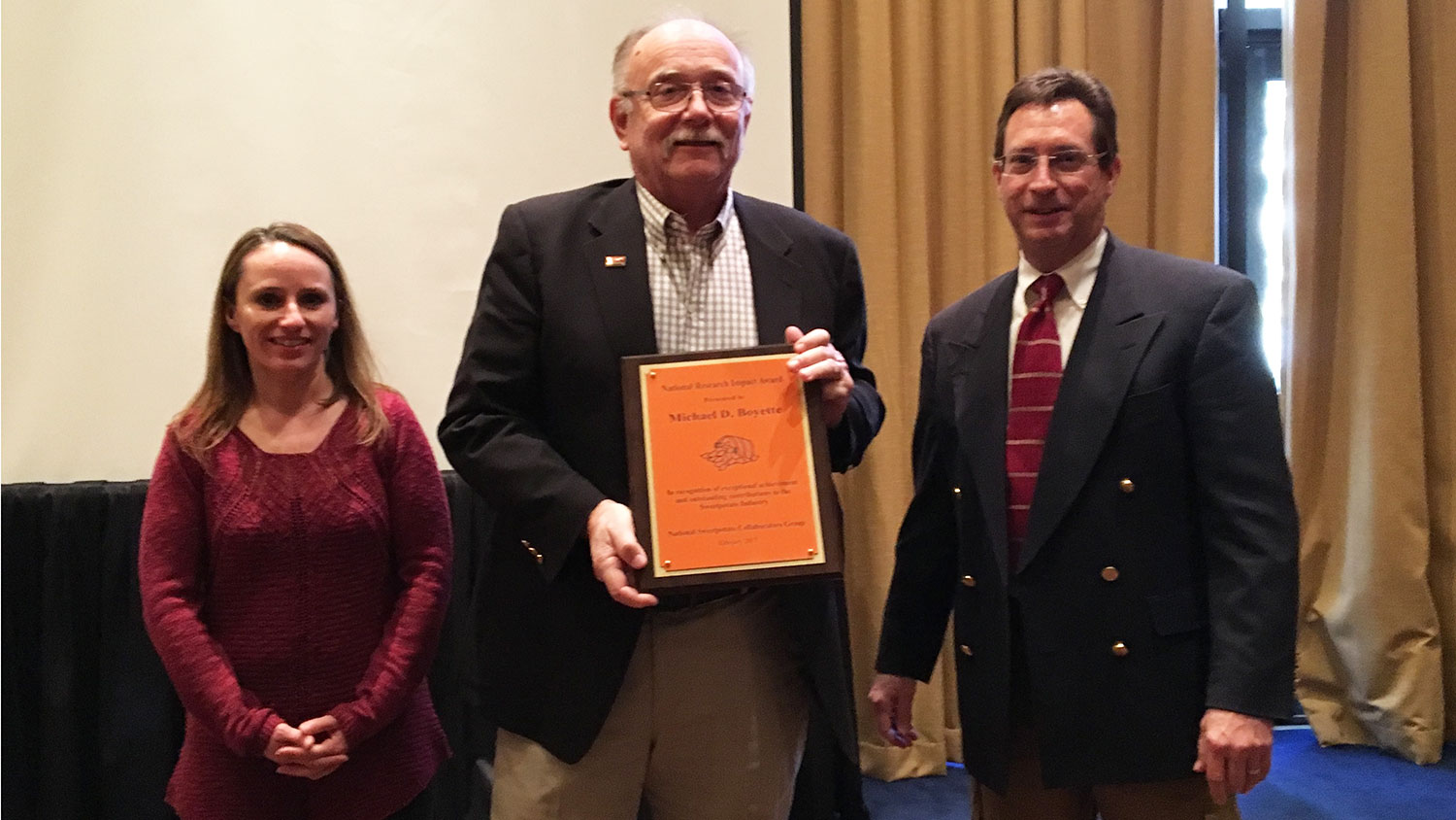 Mike Boyette receives the National Research Impact Award