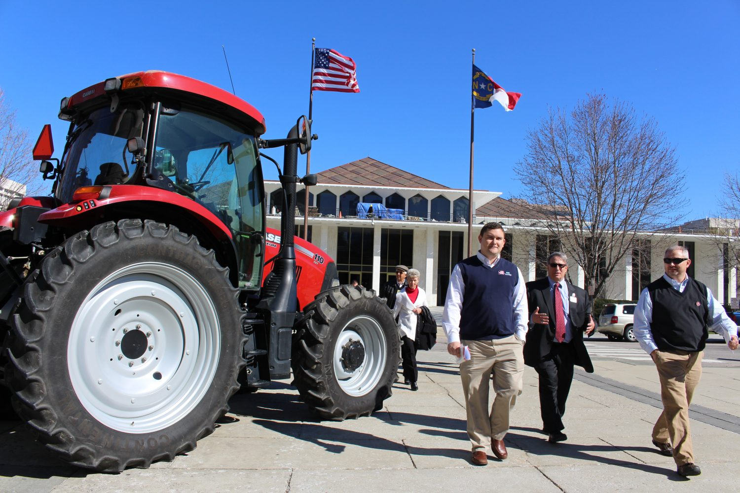 Tractor and people in front of North Carolina legislative building.