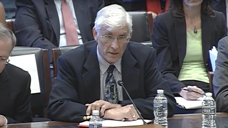 Mr. van der Hoeven at a desk in the Capitol building.