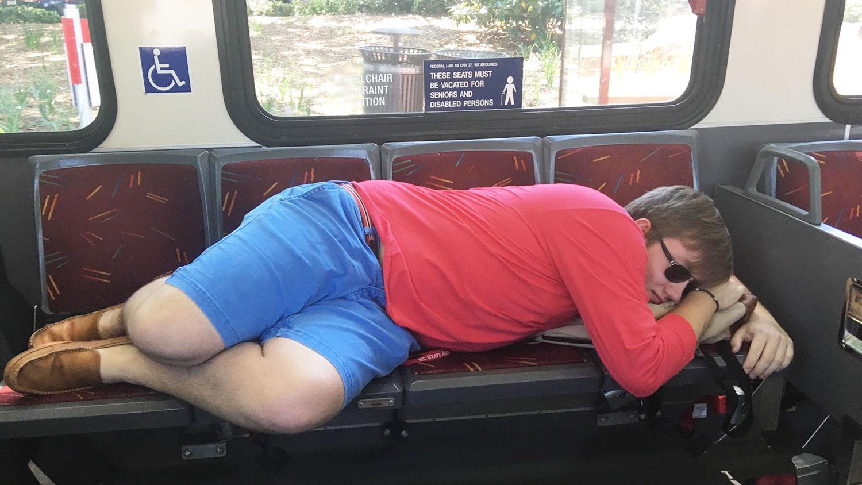 student sleeping on bus