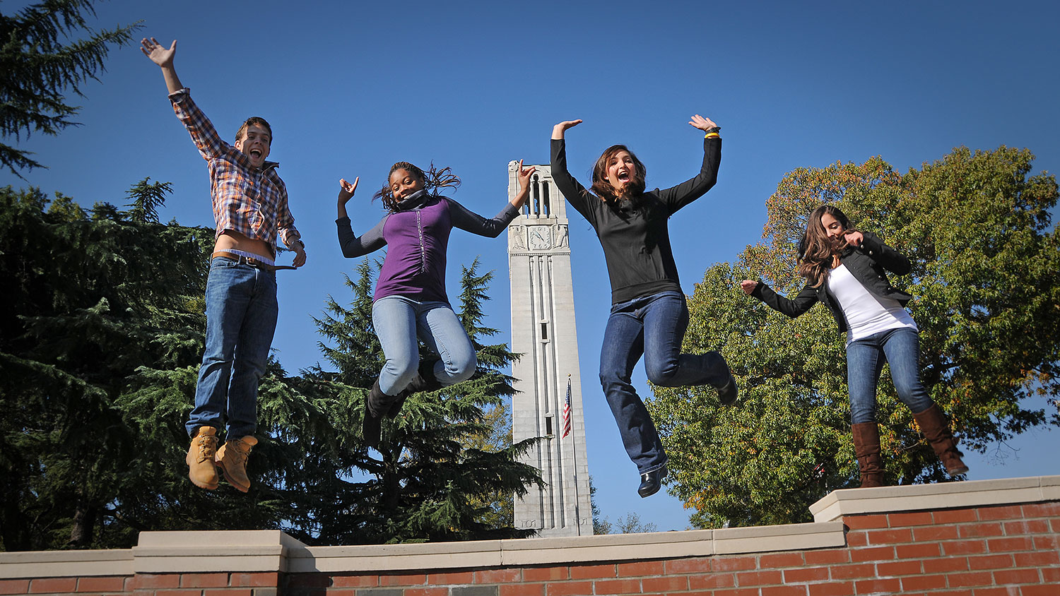 students celebrating by belltower