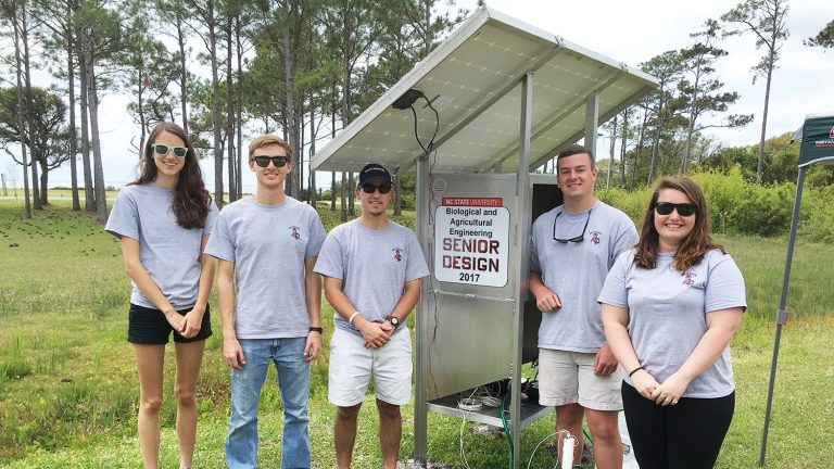 BAE senior design students with the solar-powered pump they built and installed on Harkers Island