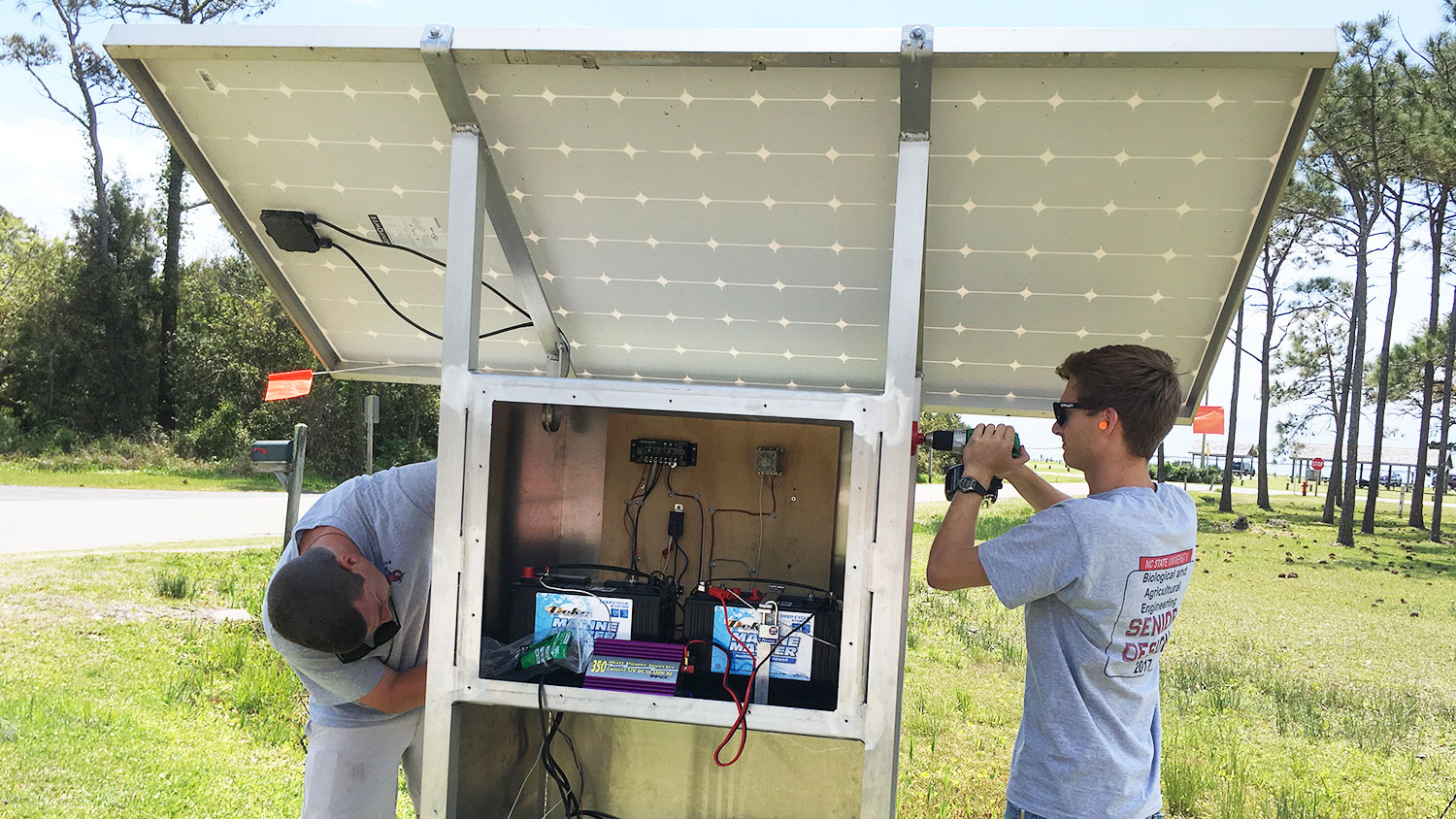 BAE senior design students work on the solar-powered pump they built and installed on Harkers Island