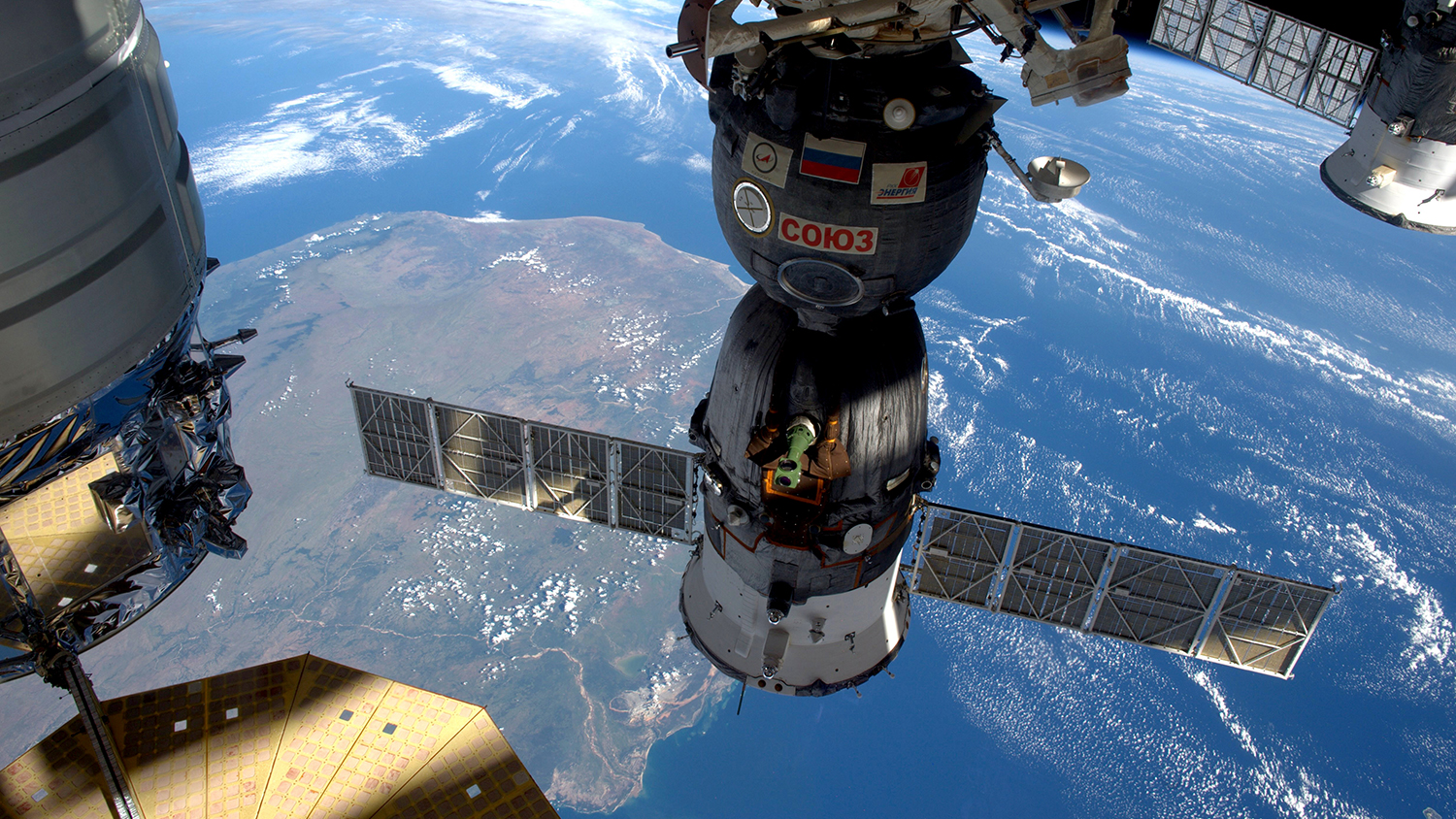 Satellite in space, with view of Earth