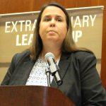 Deborah Cummings speaking at a podium
