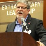Steve Lommel speaks at a podium