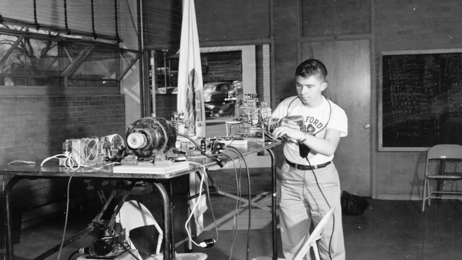 Boy with electrical experiment.