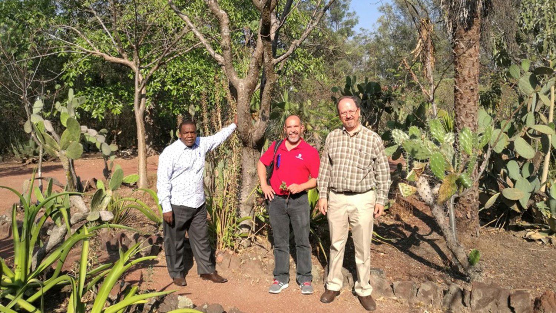 """Dr. Jose """"Trino"""" Ascencio-Ibanez with collaborators in a field in Mexico"""