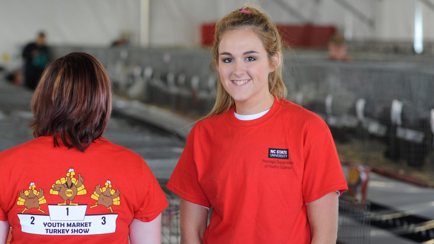 NC State students at the North Carolina State Fair's turkey exhibit