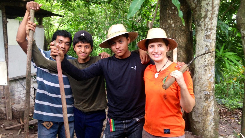 CALS grad student Angel Cruz with farmers in El Salvador