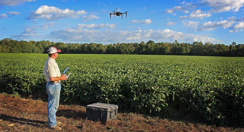 Drone flies over fields