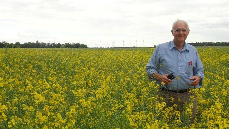 Crop Science Professor Bob Patterson standing in a field