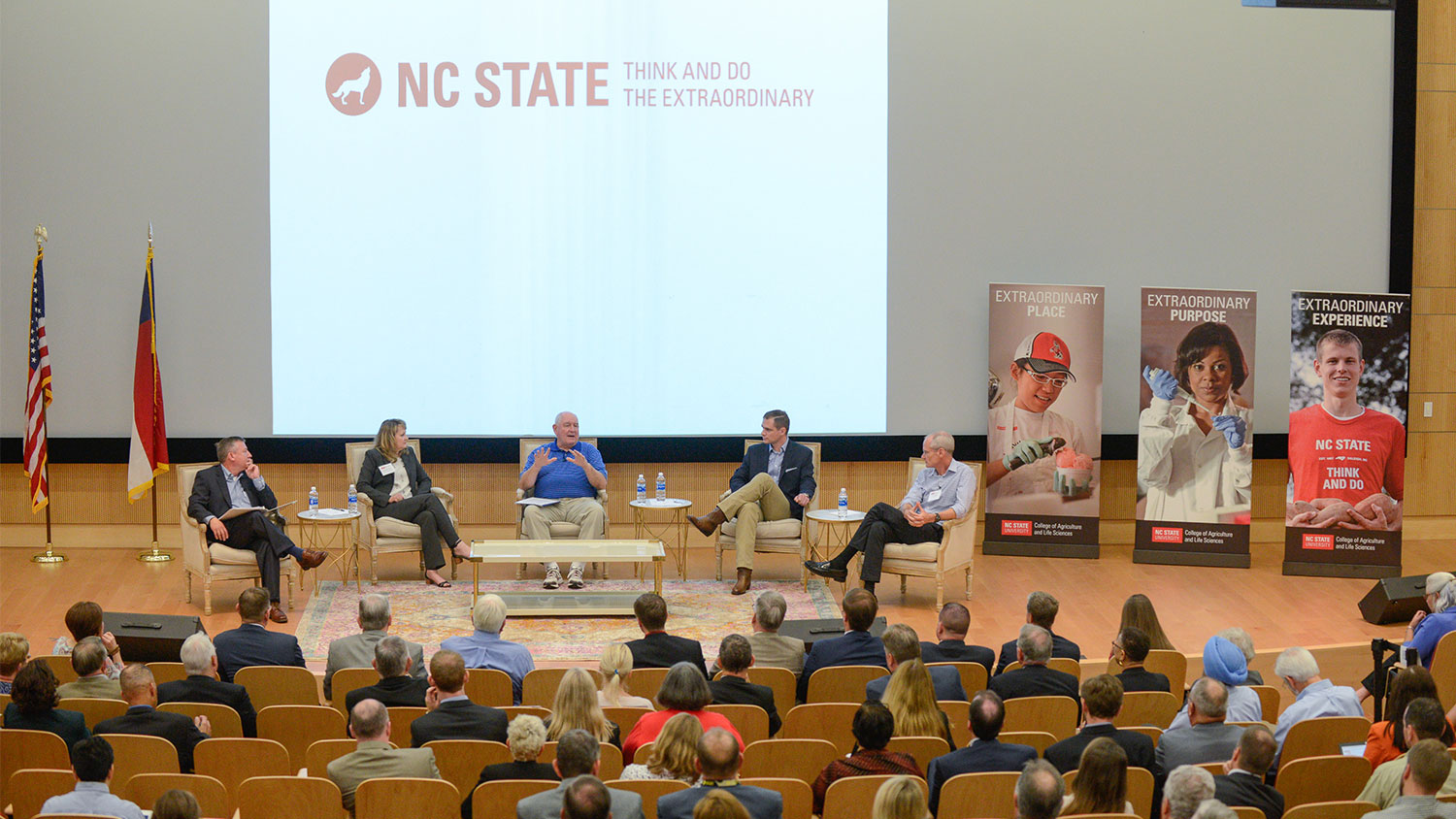 Panelists on stage in the Hunt Library auditorium.