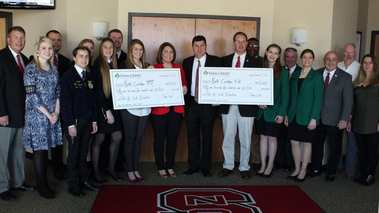 Representatives of North Carolina 4-H, North Carolina FFA and the Farm Credit Associations of North Carolina gather for a check presentation ceremony.