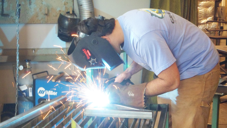 NC State senior design student welding