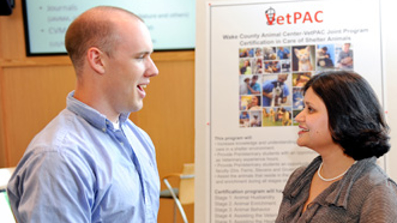 Dr. Shweta Trivedi, VetPAC director (right), speaks with James Tyndall, a CALS senior in animal science. Tyndall recently was elected 2010-11 national president of the American Pre-Veterinary Medical Association.