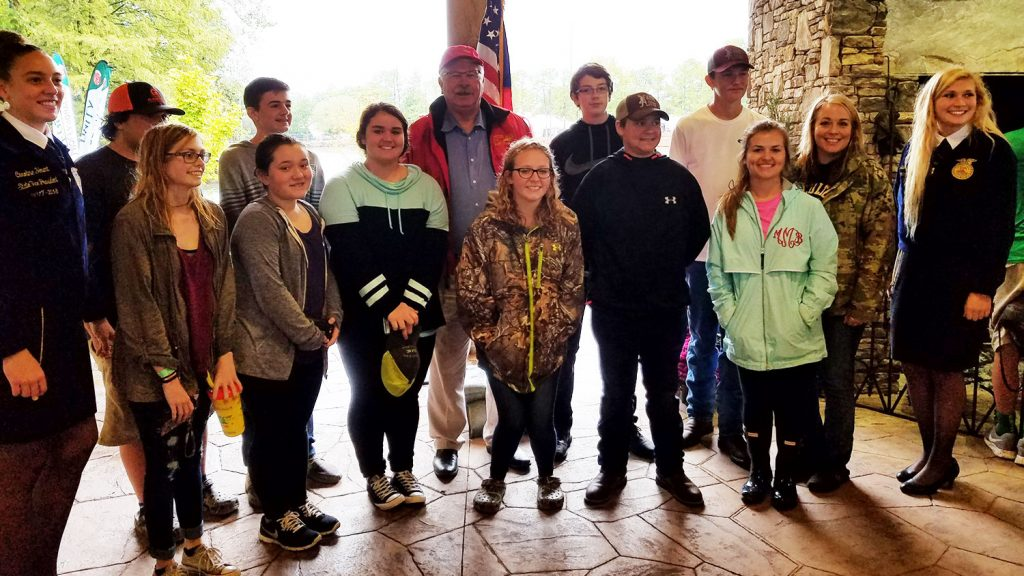 Jackie and her students meet with North Carolina Agriculture Commissioner Steve Troxler during a field trip to the N.C. State Fair.