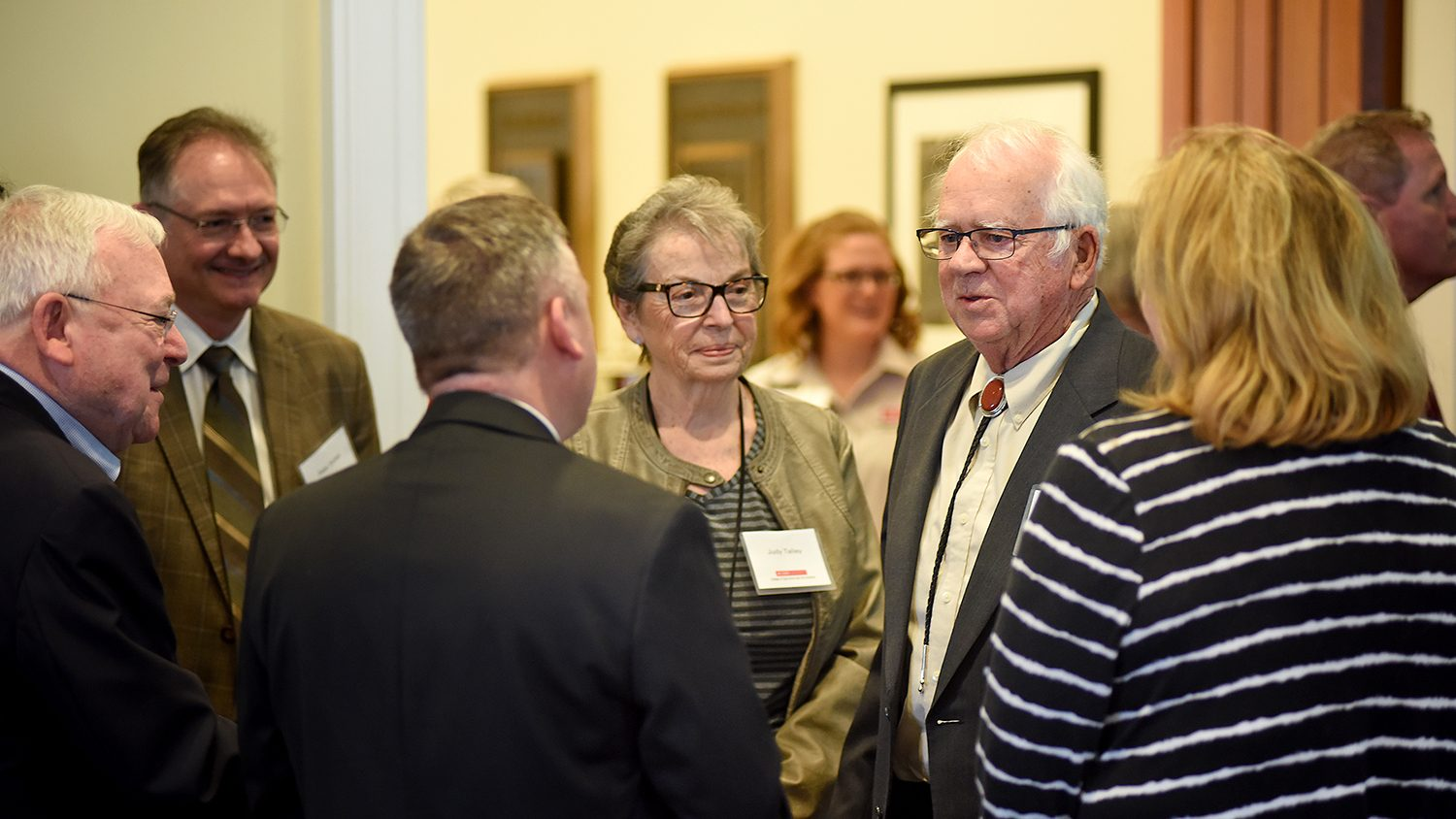 Windell (right) and Judy Talley greet Dean Richard Linton and other CALS faculty and administration before the start of the turkey unit dedication.