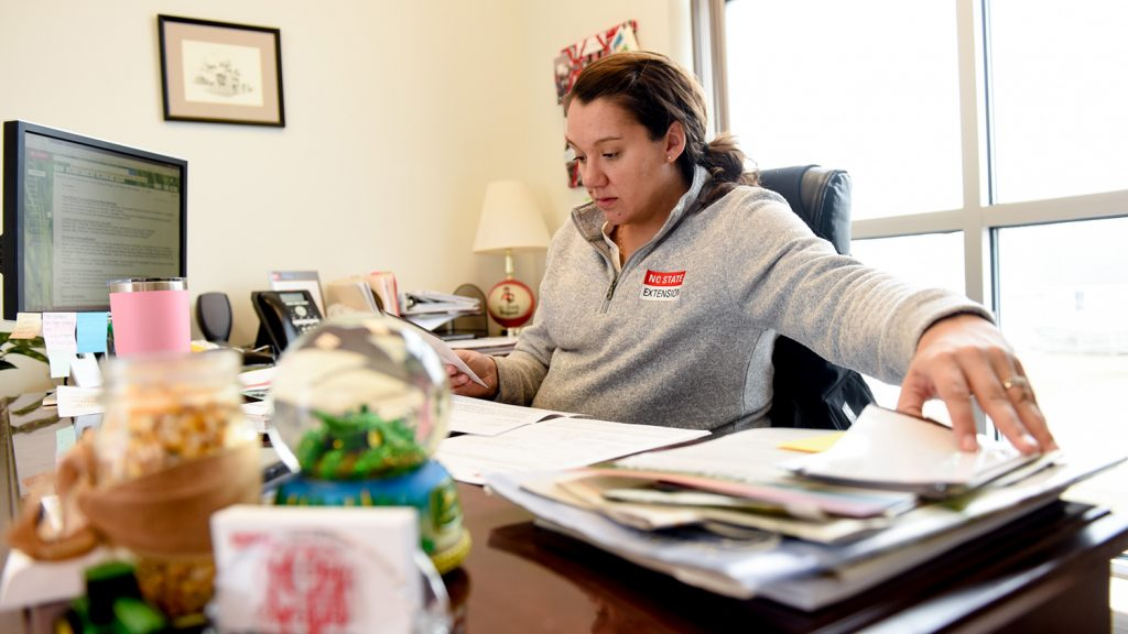 NC State Extension Agent Andrea Gibbs works at her desk.
