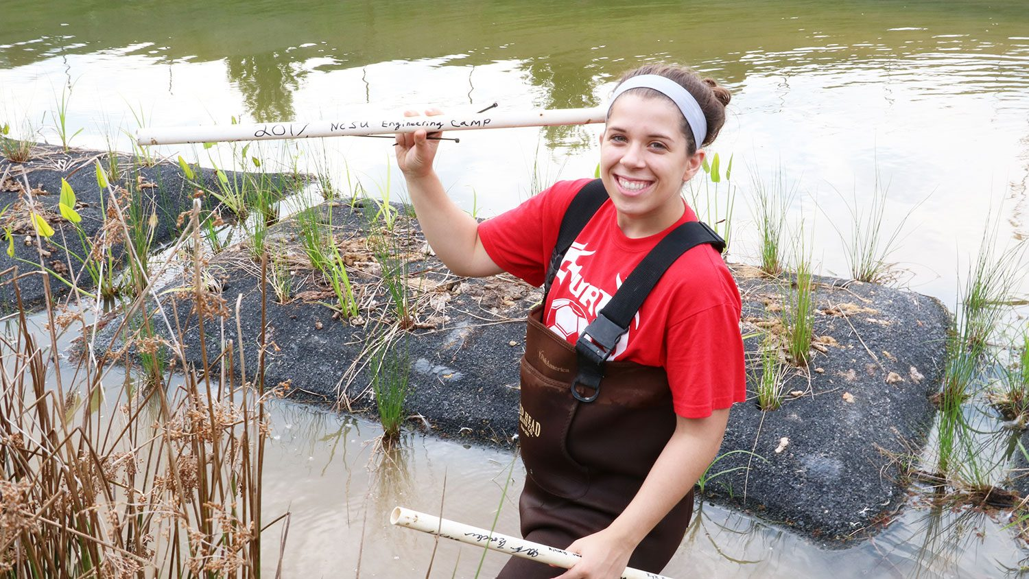 NC State student Dani Winter working in a pond