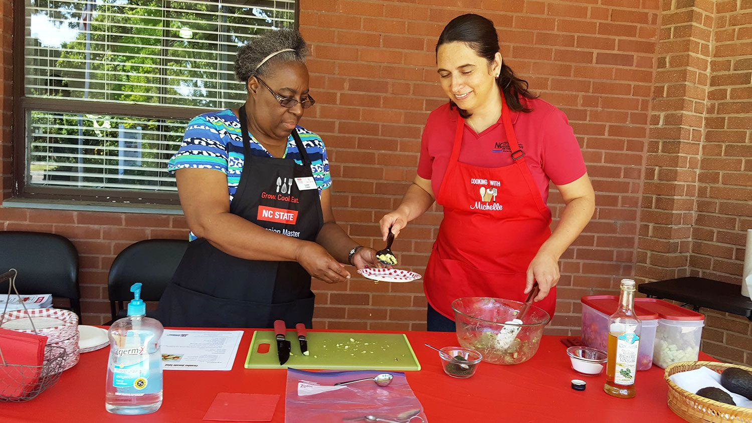 Extension Master Food Volunteers conduct a cooking demonstration.