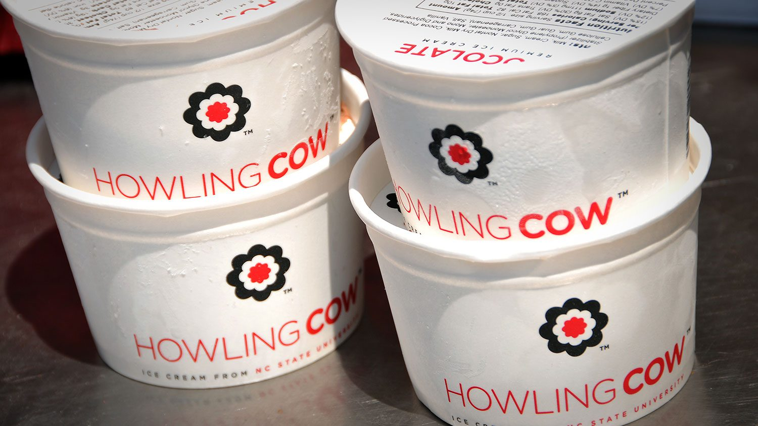 Stacked containers of Howling Cow ice cream