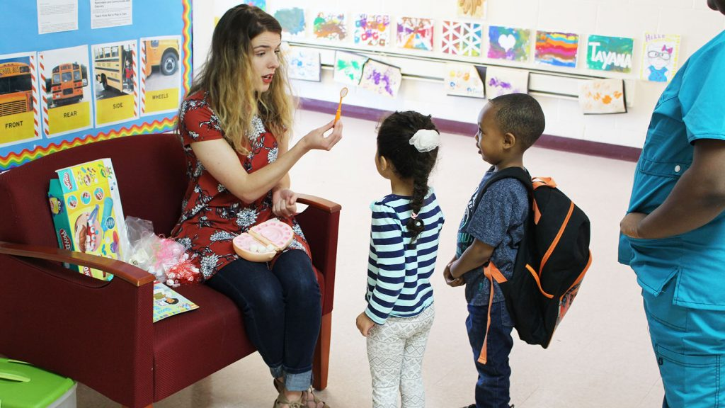 NC State student teaching preschoolers about dental health