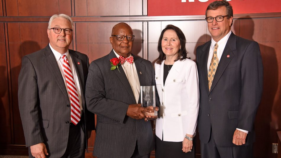 Left to right, Chancellor Randy Woodson, Cassius Williams, Libby Godwin and Trent Ragland at the Godwin Red Torch Award dinner.