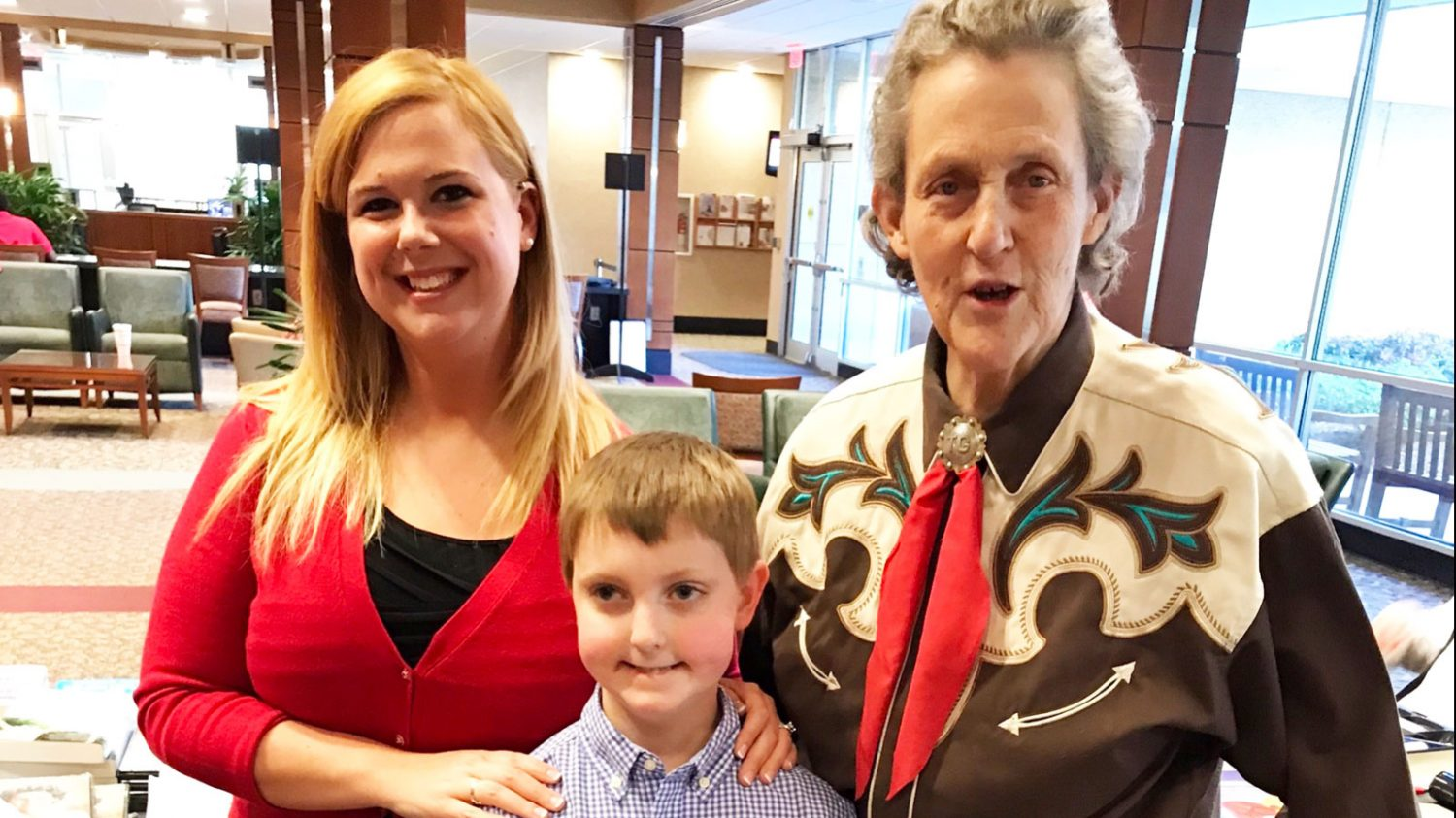 Danielle Pennington and her son Jacob with Temple Grandin.
