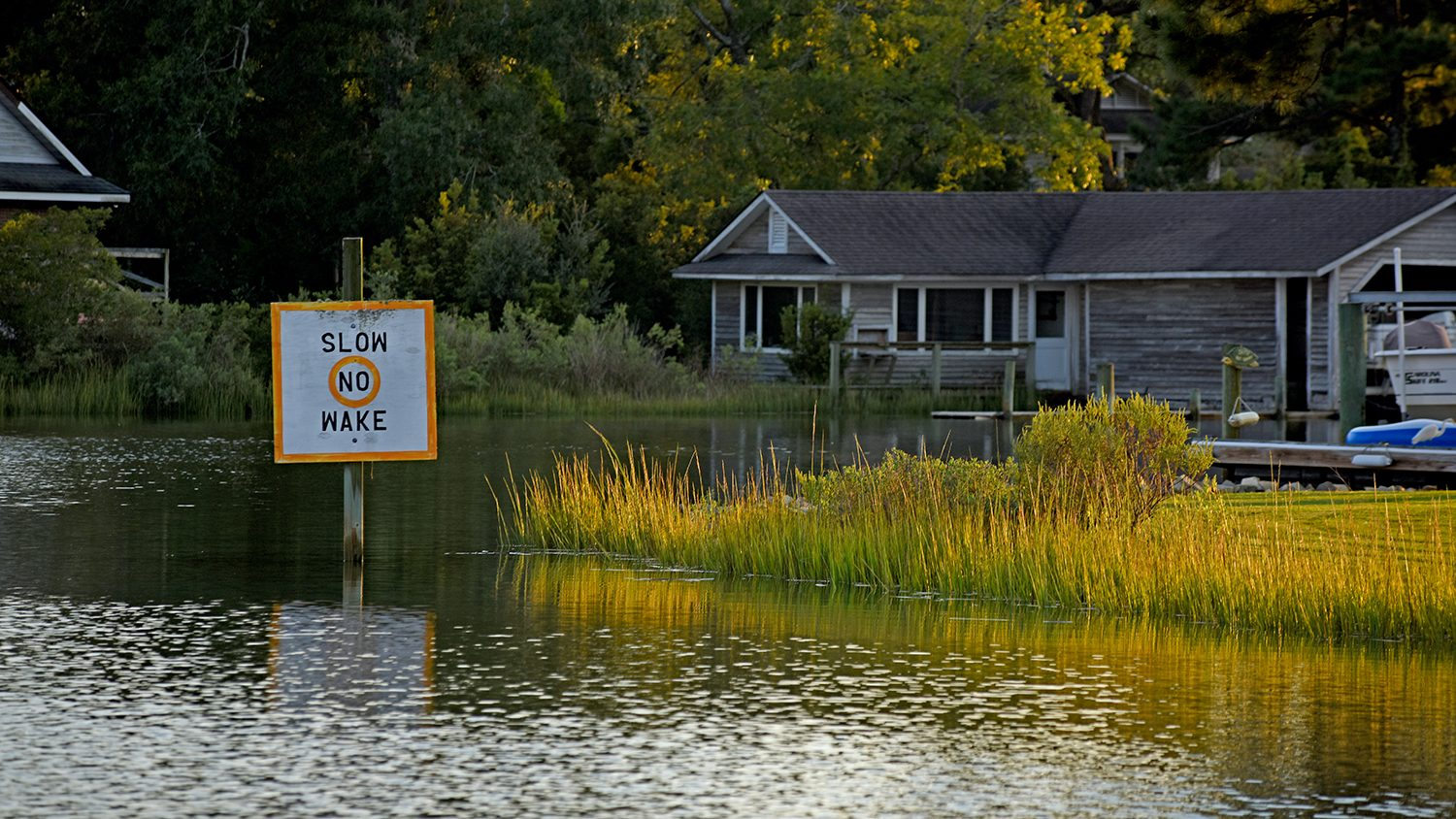 "A ""no wake zone"" near homes and docks along Peletier Creek in Morehead City."