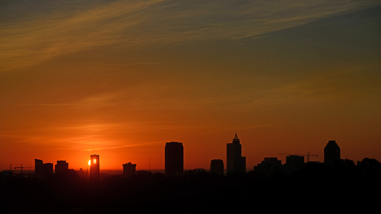 Sun rise silhouettes the Raleigh skyline