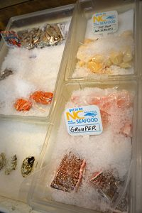 Local seafood laid out in a supermarket for purchase.