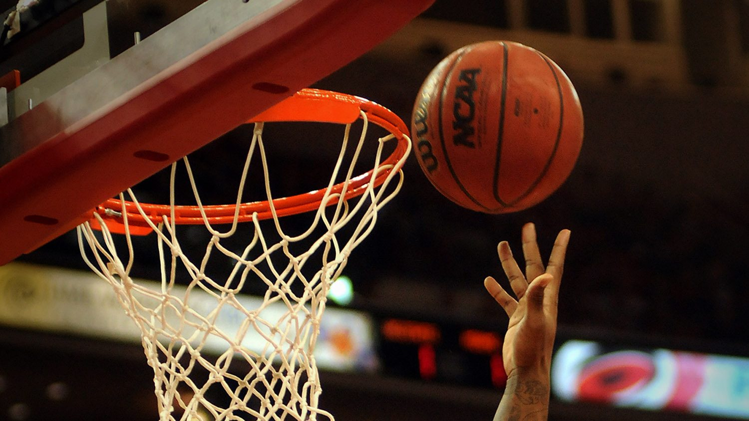 CALS' Mike Walden asks whether pro athletes are overpaid; photo of basketball and hoop