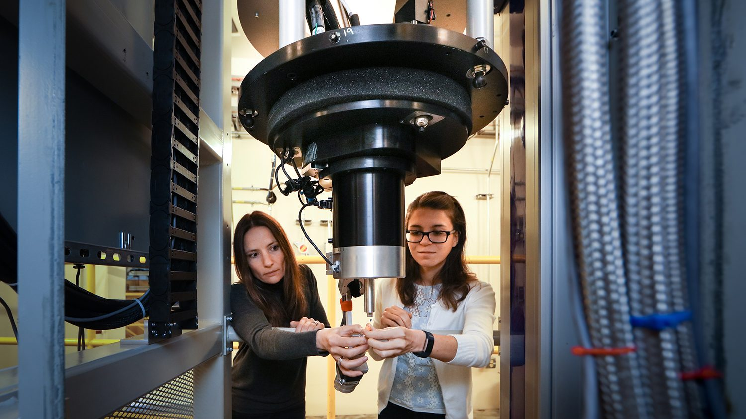 CALS' Flora Meilleur and Gabriela Schroder in the Oak Ridge National Laboratories working with the world's largest neutron source.