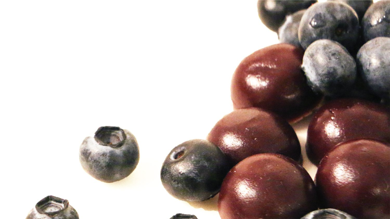 Close up of blueberries and blueberry gummies.