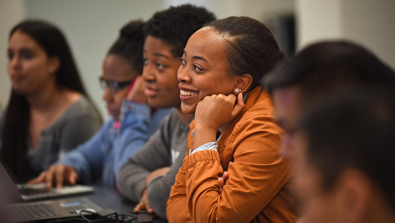 Student listens to a classmate's presentation in Dr. Paul Mozdziak's Scott Hall lab.