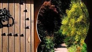 Door opening onto walkway in garden