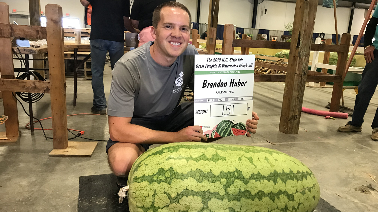 Brandon Huber, showing off his 151-pound watermelon at the NC State Fair.