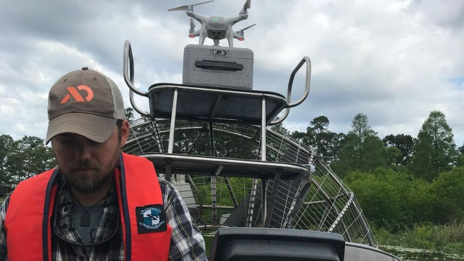 A man researches aquatic weeds with drones