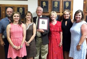 Skroch (center) is joined by his family during the May 29 induction ceremony.
