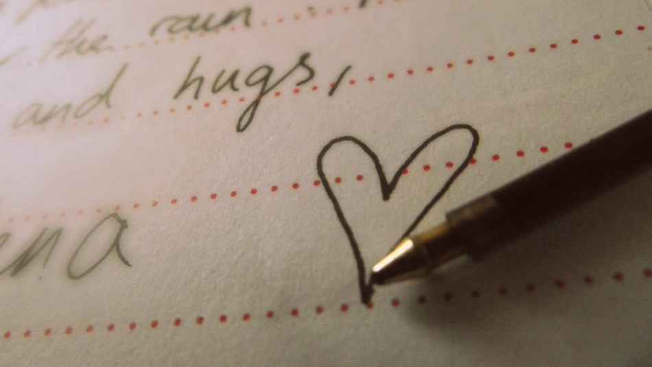 "handwritten word ""hugs"" and a heart"