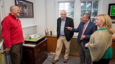 Richard Whitaker (center) inspects a scale model of the Plant Sciences Building after he gave Dean Richard Linton (right) a $7000 check from North Carolina Greenhouse Vegetable Growers' Association for the building. Launch Director Steve Briggs (left) and Senior Director of Development Dinah Schuster (far right) observe.