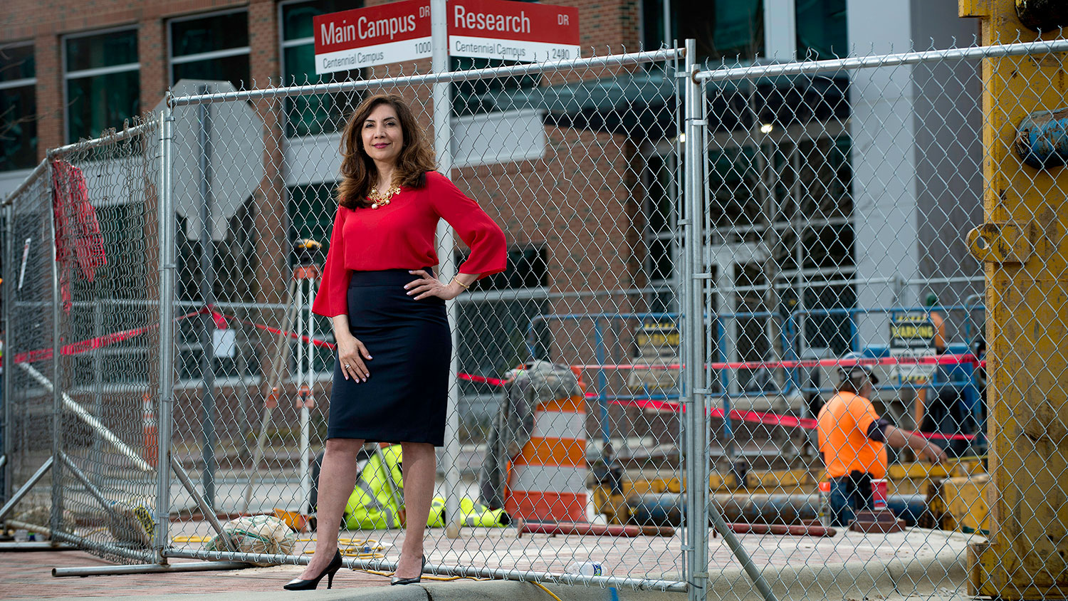 A woman standing in a construction area of NC State's campus.