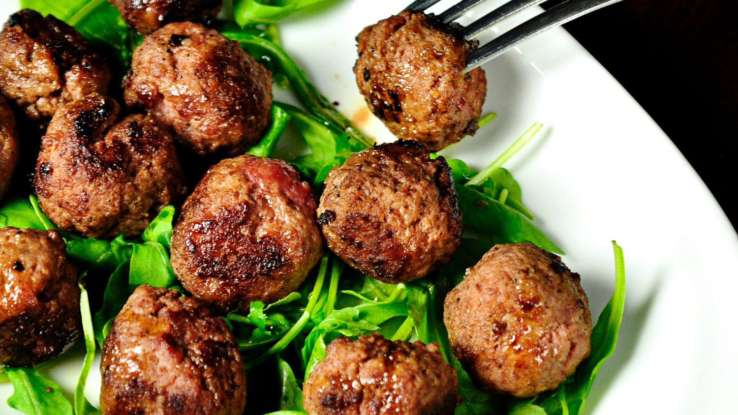 Meatballs and greens on a plate