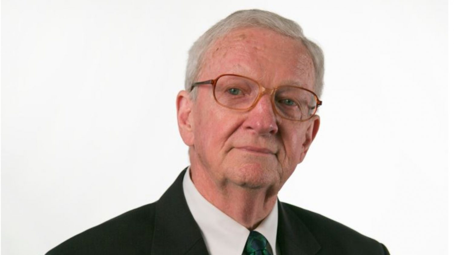 Head and shoulders shot of man against a white background
