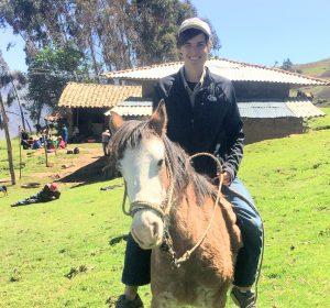 Mark Watson on horseback in the mountains