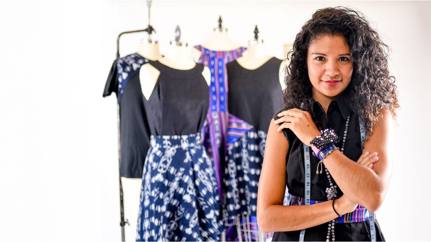 Lisbeth Carolina Arias with clothing she designed